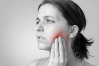 woman with tooth pain  teeth  jaw  wisdom teeth